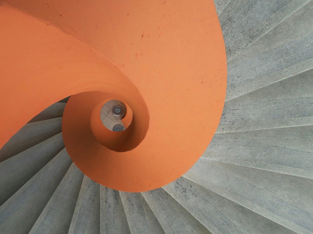 image of an orange and grey spiral staircase