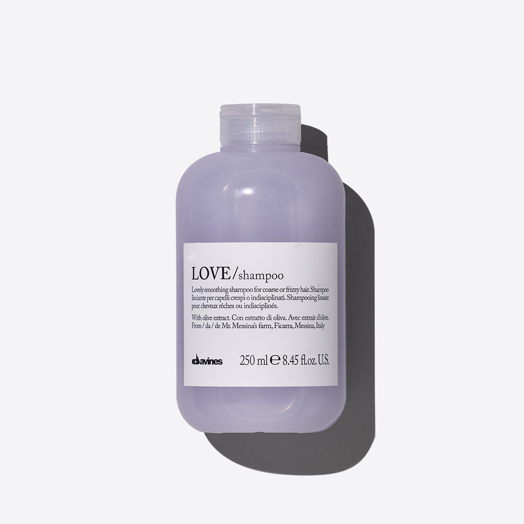 Purple Love smoothing Shampoo in a clear bottle with a white label
