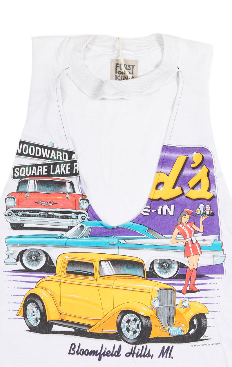 SLEEVELESS TEE WITH CUT OUT FRONT