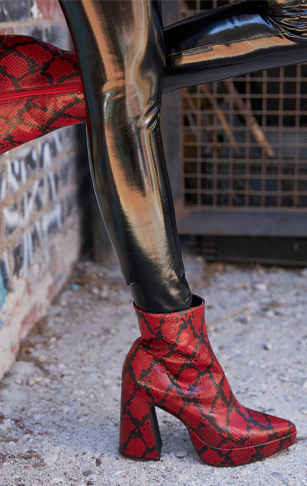 DORMANT SNAKE PLATFORM BOOT WITH SCULPTED HEEL