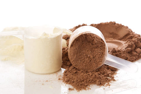 scoops of whey protein powder