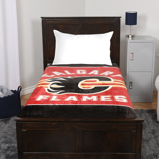 A blanket throw with the Calgary Flames logo