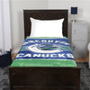 A blanket throw with the Vancouver Canucks logo