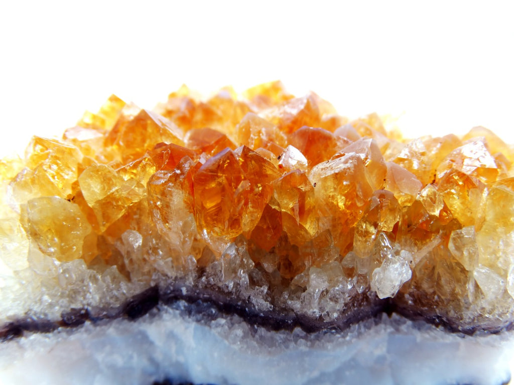 Cluster of citrine crystals on top of a quartz.