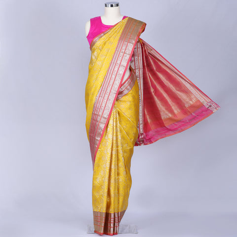 Yellow and peach silver zari silk saree