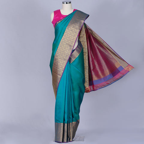 Peacock green designer silk saree