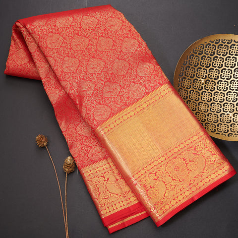 Red Kanchi silk saree with purple blouse and pallu