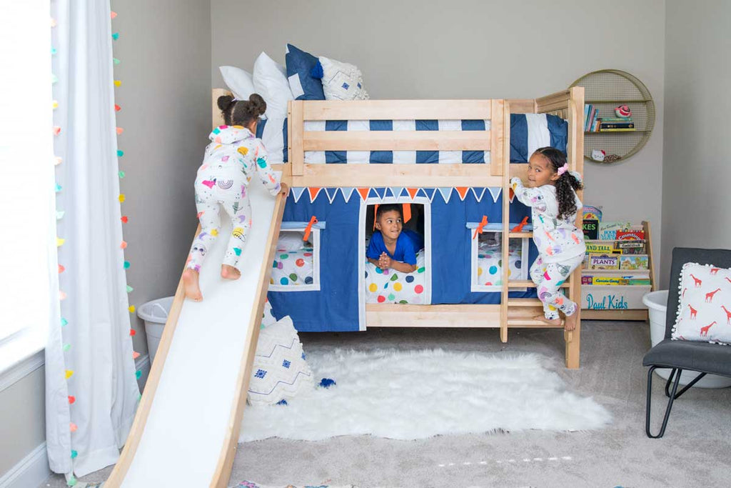 low bunk bed with slide and curtains for twins preschool room