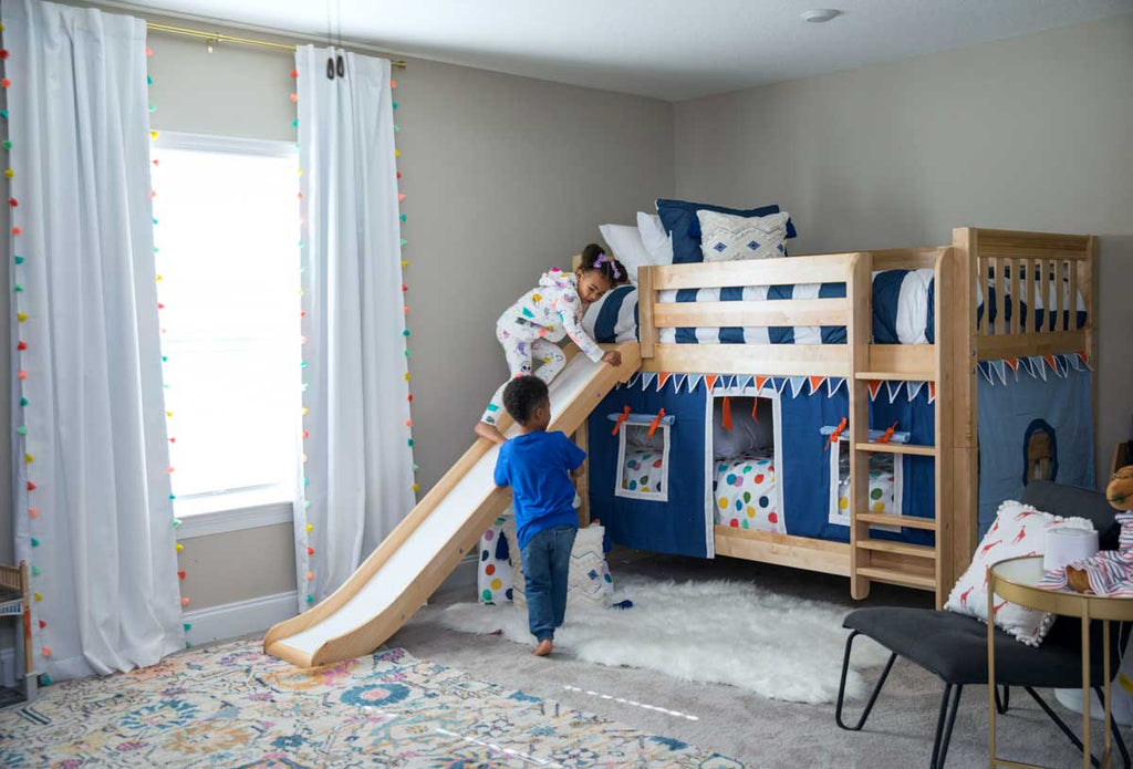 twin bunk beds with slide and curtain