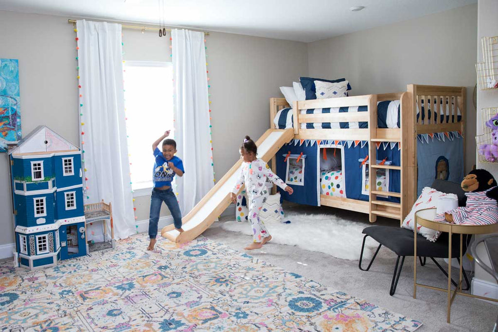 large shared kids room with bunk beds and slide