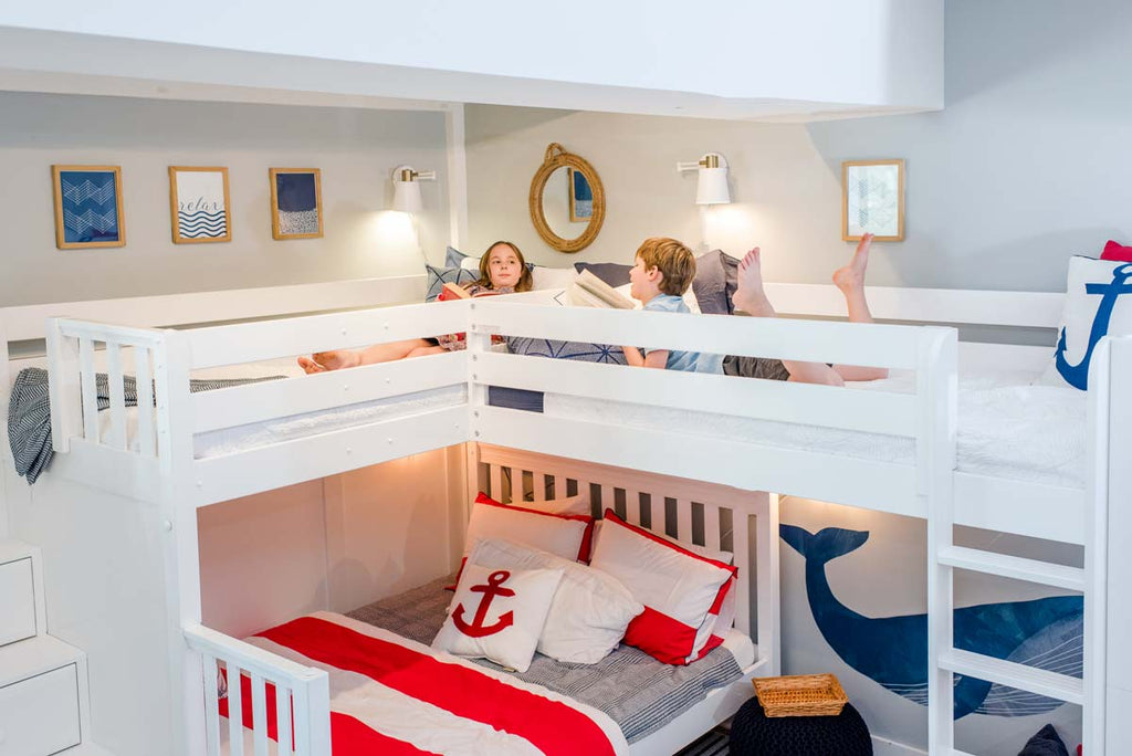 two kids up high on corner bunk bed