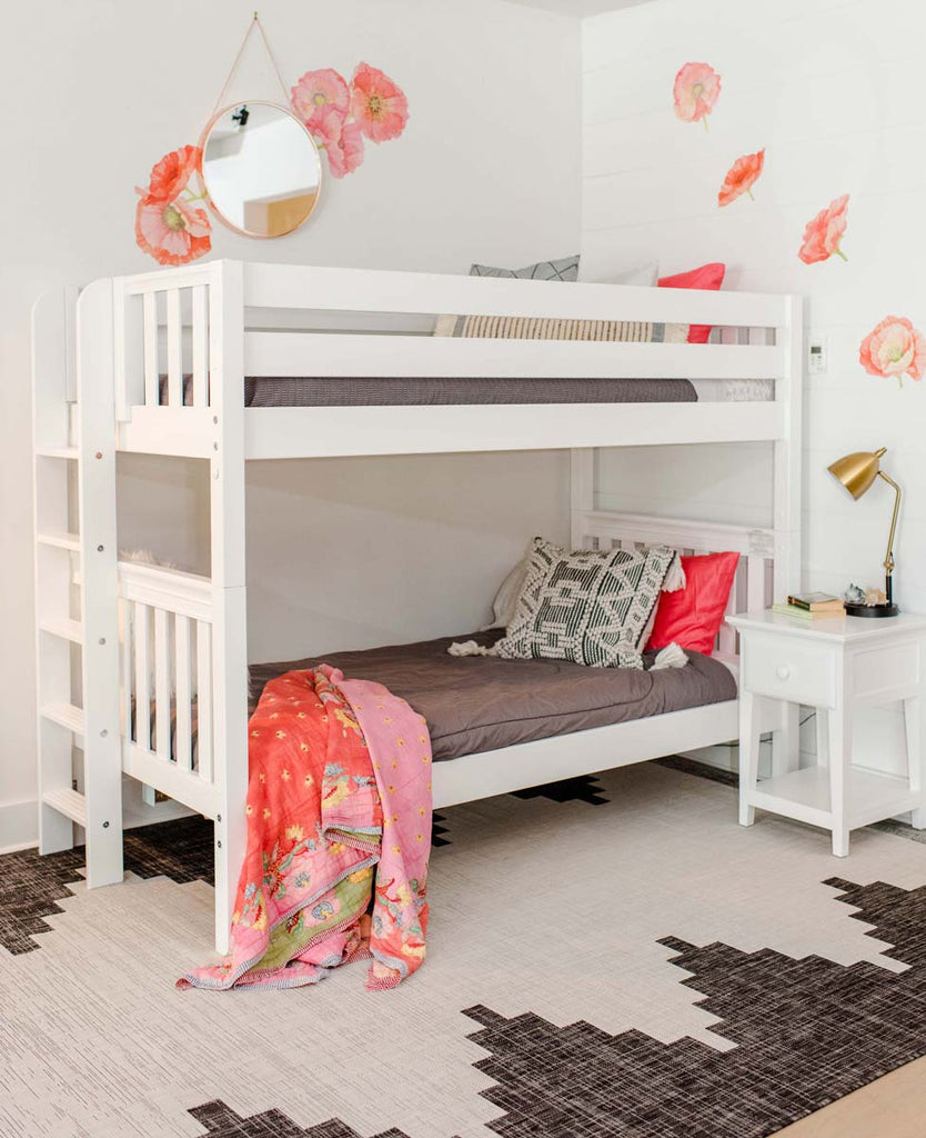 twin bunk bed with ladder on bed end