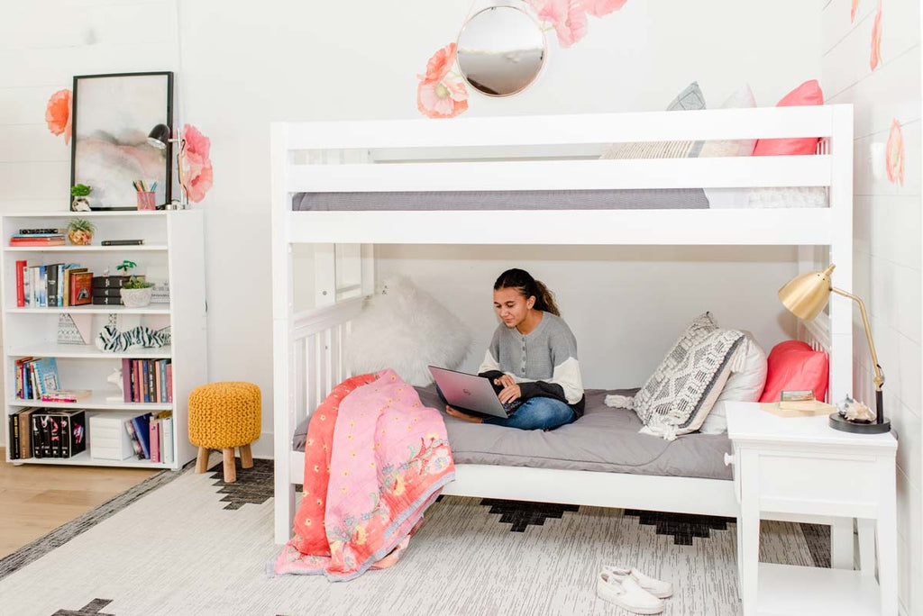 tween girls room bunk bed with ladder on end