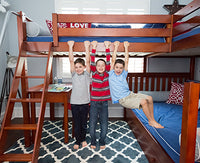 3 boys playing on triple bunk bed with stairs