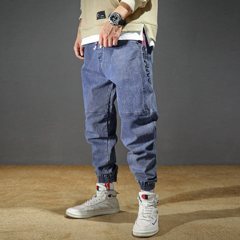 STRETCHY LOOSE TAPPERED JEANS