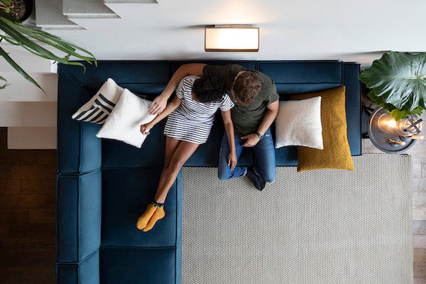 Blue corner sofa with man and woman lounging