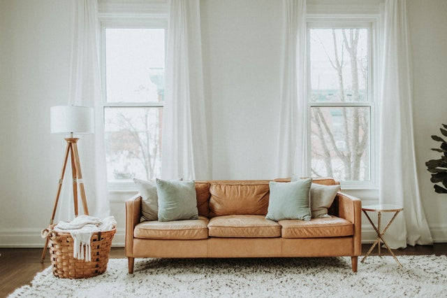 Brown leather sofa in white living room
