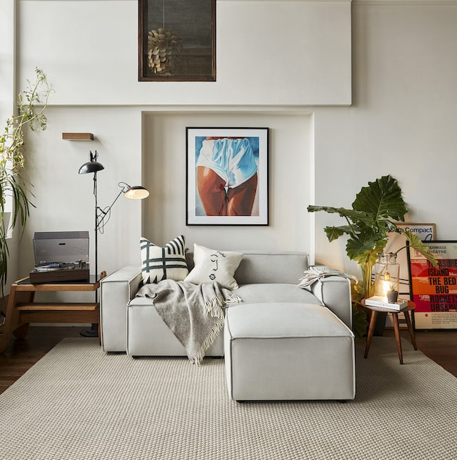 Small L-shaped sofa against wall