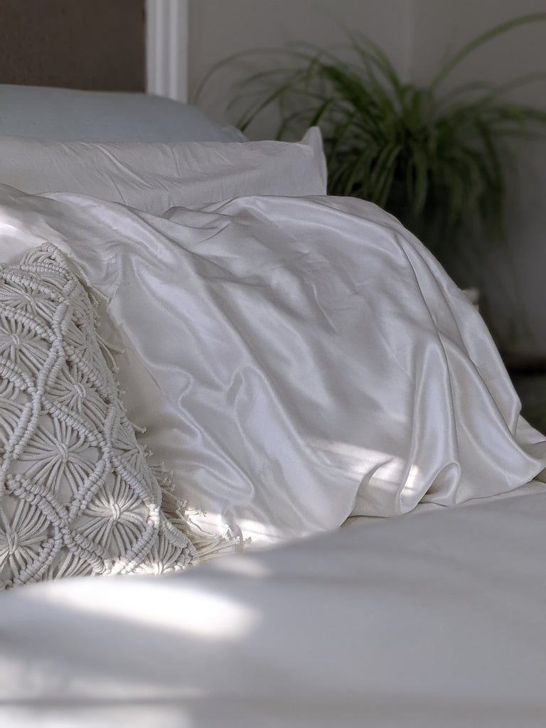 Luxury bed linens draped