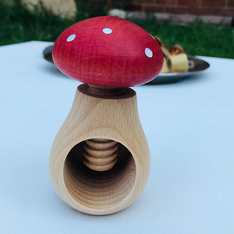 Red and white polka dot wooden mushroom