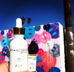 Illuminate Brightening Serum in front of Smile Wall on Melrose in Los Angeles