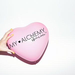 pink heart balloon with my alchemy skin care