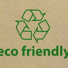eco friendly logo in green on recycled cardboard