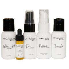 My Alchemy Skin Care Line of products. White bottles with black and white labels