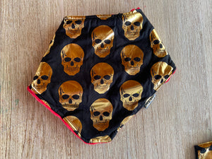 April Made Gold Skulls Bib