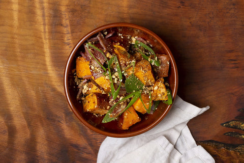 Honey roasted kumara with crispy bacon, green onions & dukkah