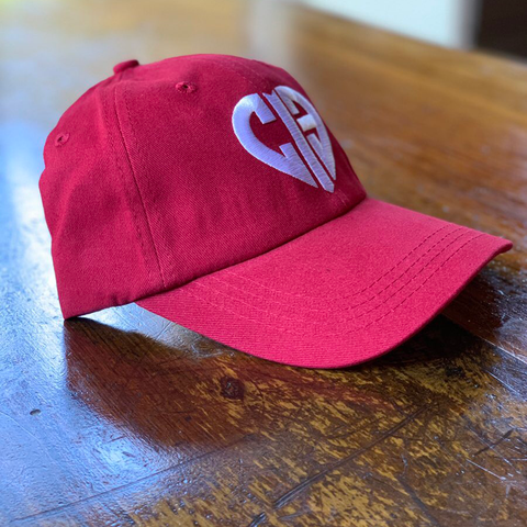 CIB red hat with white heart logo