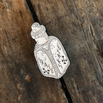 CIB White and Silver Pin shaped as a poison bottle with Skate in angled text