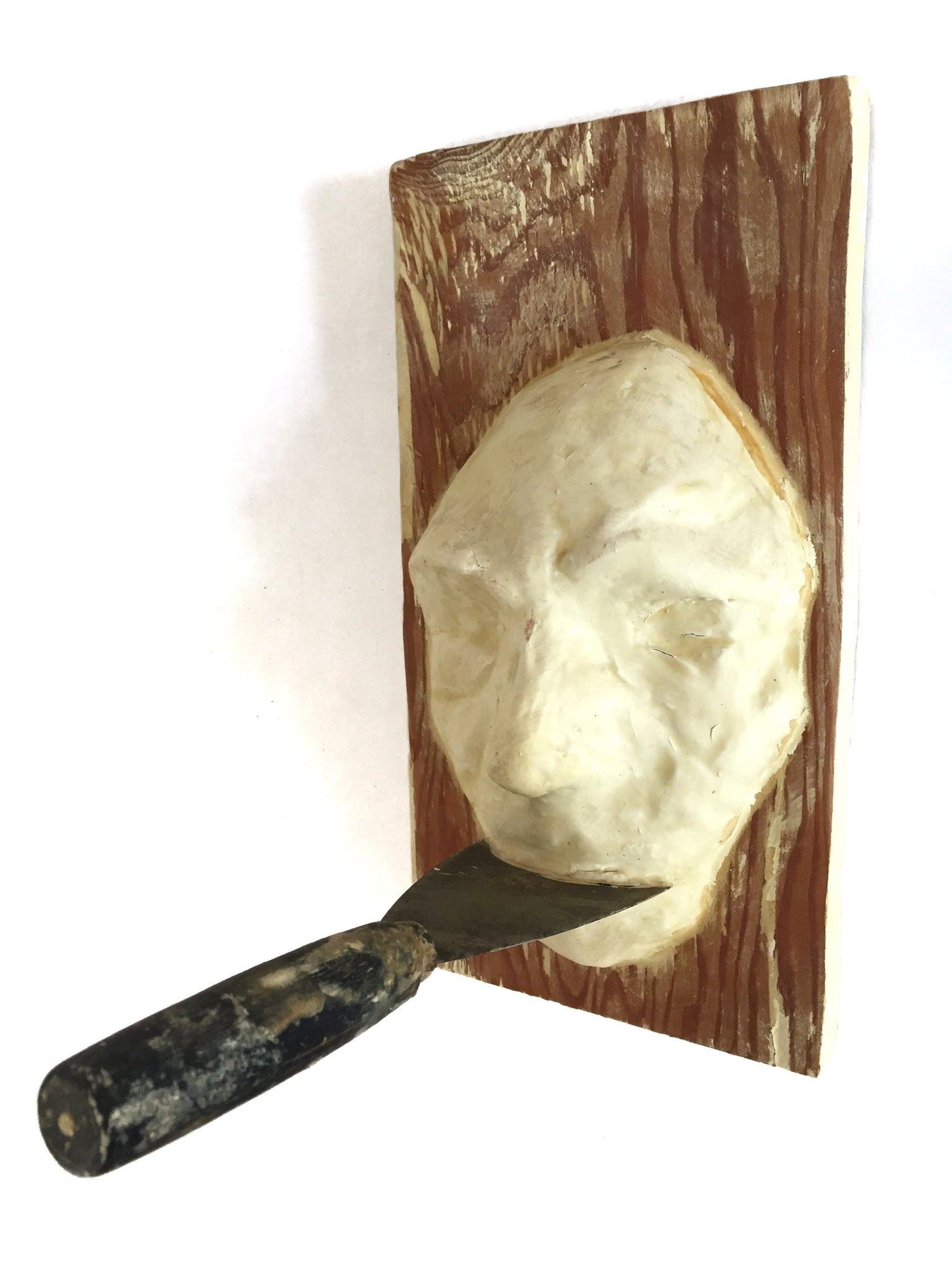Mask with putty knife by Tyler James Hoare