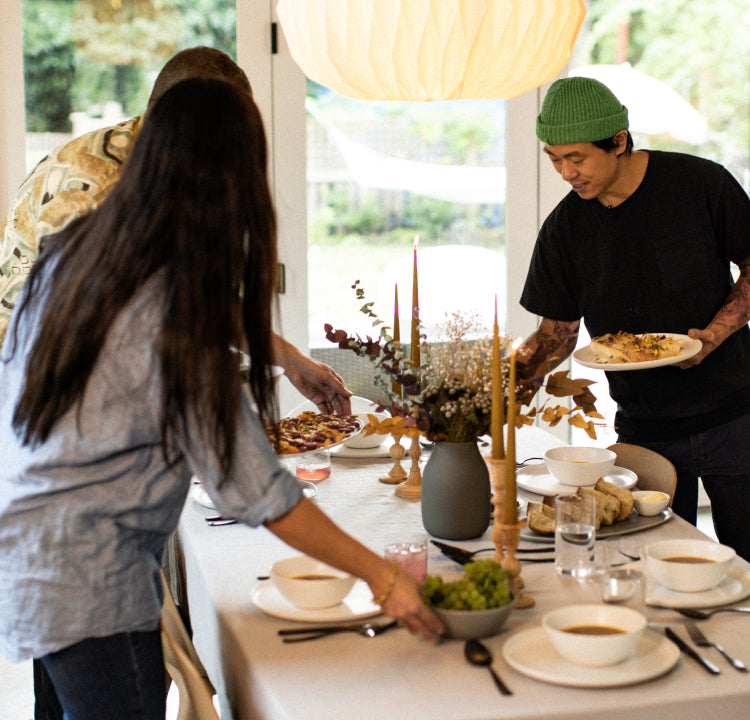 Dinner party setting the table with friends