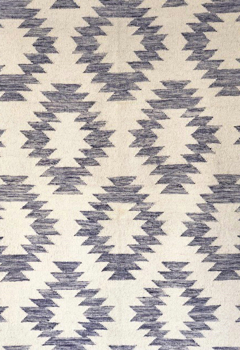 geometric rug with blue pattern