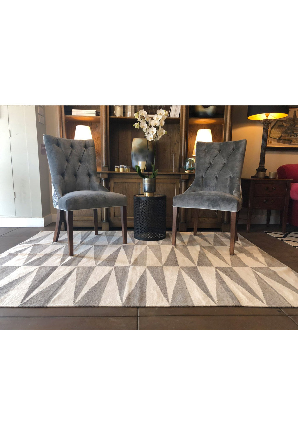 grey geometric rug in room