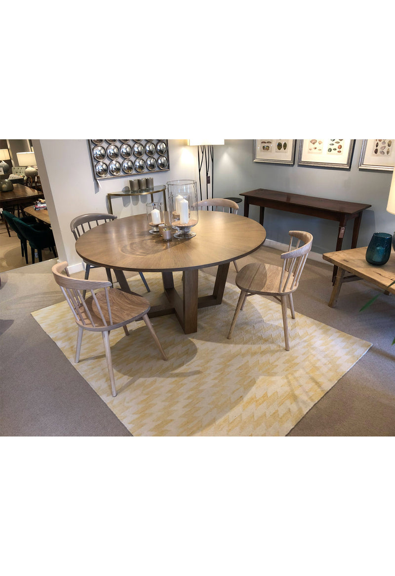 modern yellow rug in dining room