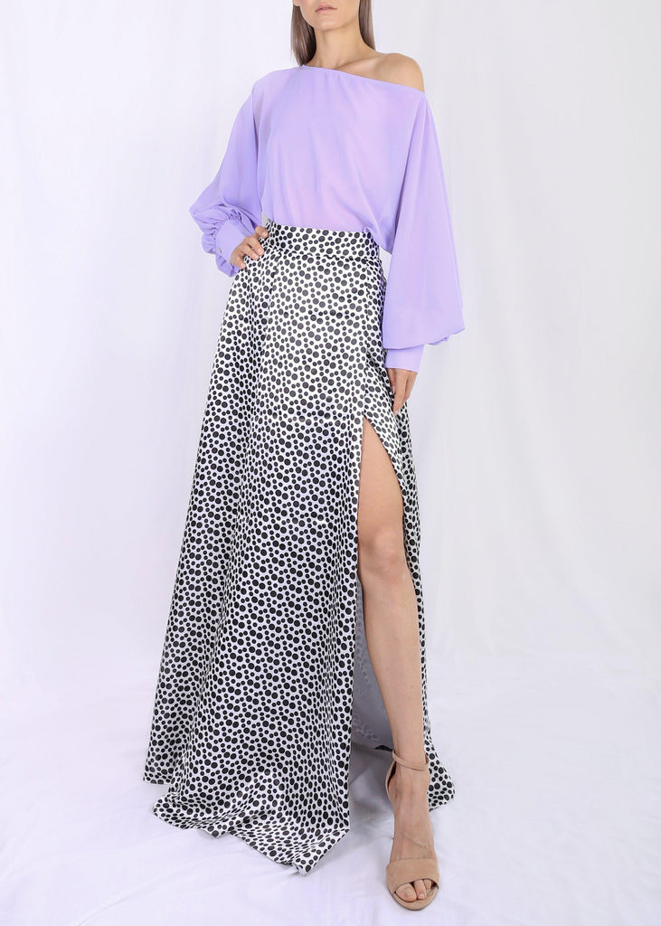 Maxi length skirt One leg opening Invisible zipper closure Fully lined 100% Satin Polyester