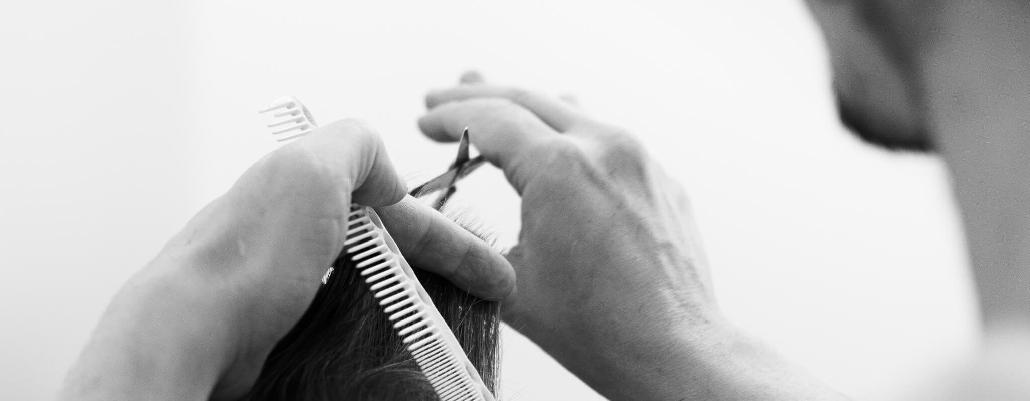 Hair being cut with scissor and comb