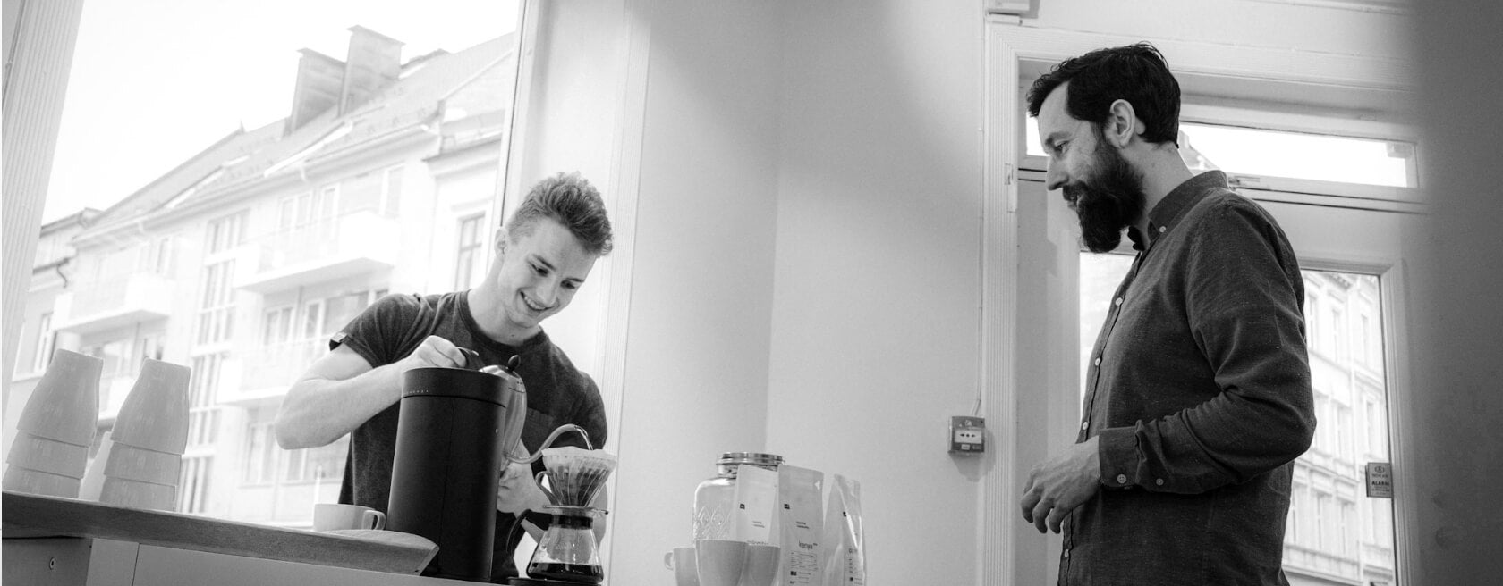 Sander Knutsen brewing V60 coffee at 1o1BARBERS event, CoffeeBeats