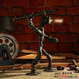 Creative iron pipe loft retro light coffee bar water pipe robot table lamp