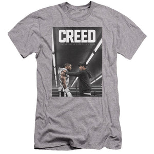 michael-b.jordan-as-adonis-creed-standing-in-a-boxing-with-his-coach-premium-canvas-brand-t-shirt-in-gray