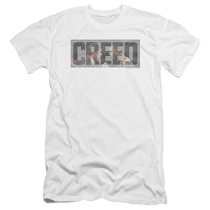 the-name-creed-superimposed-over-adonis-getting-a-pep-talk-from-his-coach-sylvester-stallone-premium-canvas-brand-adult-t-shirt-in-white