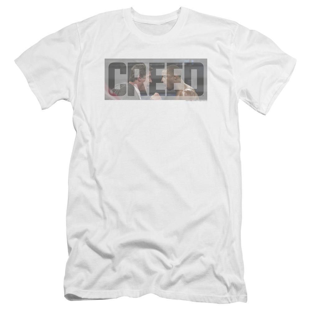 the-name-creed-superimposed-over-adonis-getting-a-pep-talk-from-his-coach-sylvester-stallone-premium-canvas-brand-t-shirt-in-white