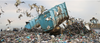 Birds fly away as huge truckload of garbage is emptied into Cape Town landfill site
