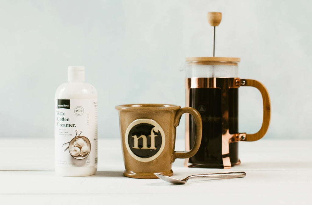 keto coffee creamer beside natural force coffee mug and french press with mold and mycotoxin free clean coffee