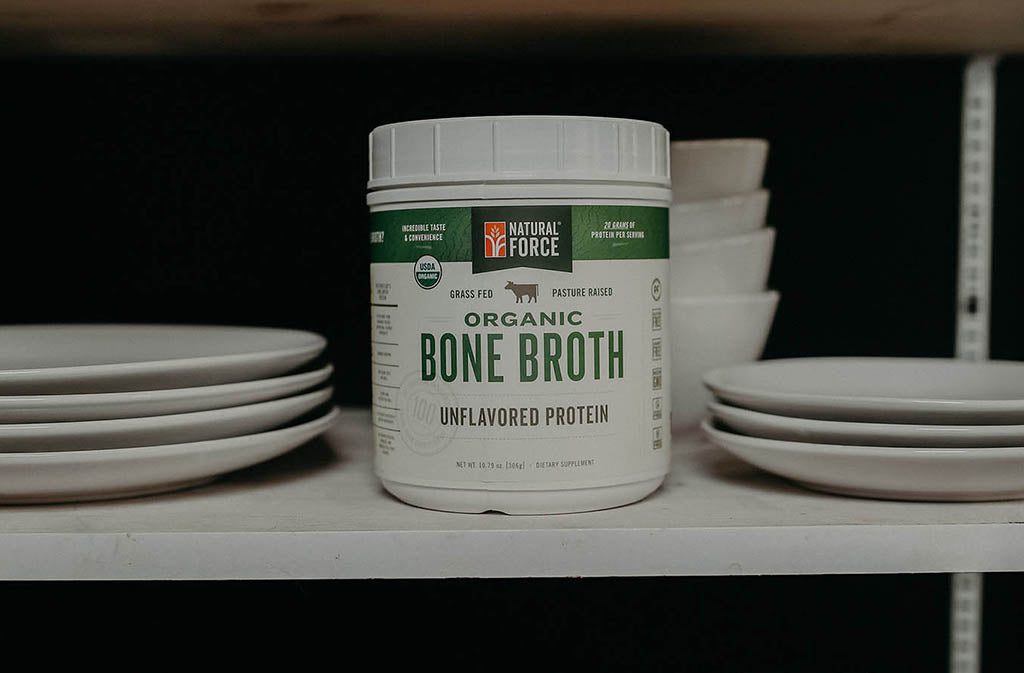 container of natural force organic bone broth protein on a shelf