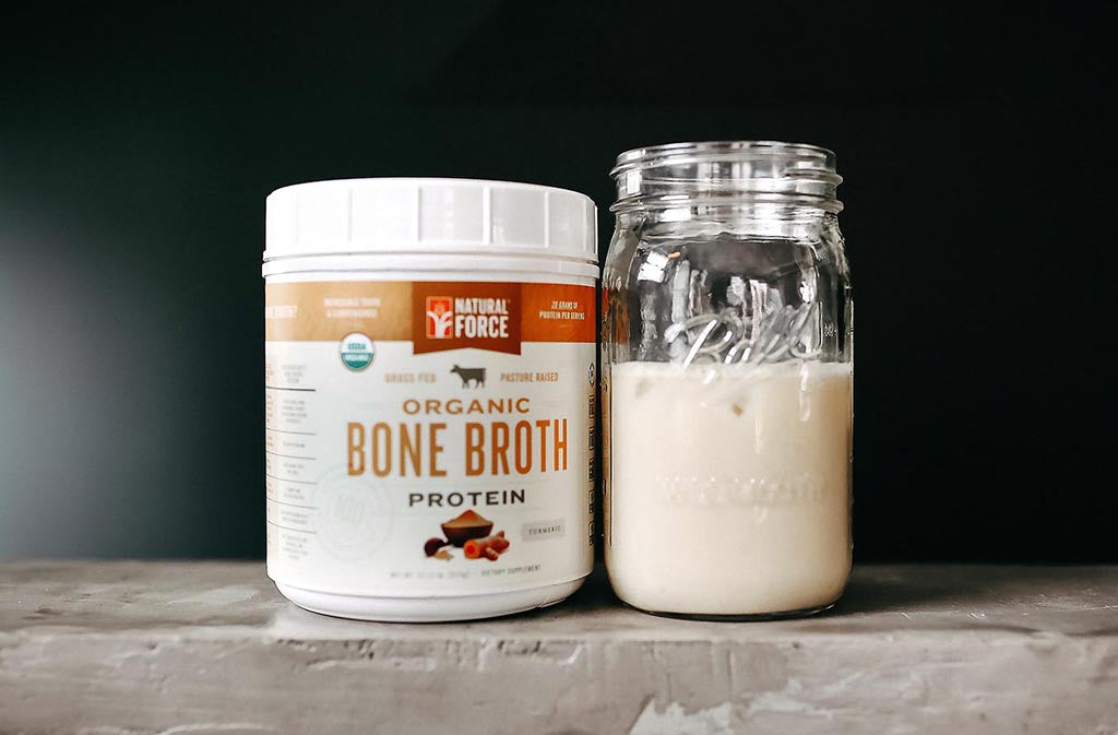 natural force organic turmeric bone broth protein beside a ball jar of keto protein shake