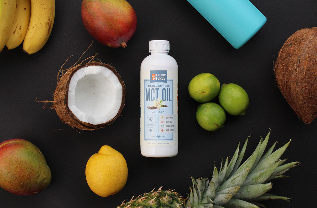 Natural Force Keto Coffee Creamer surrounded by tropical fruit - what does MCT Oil do?