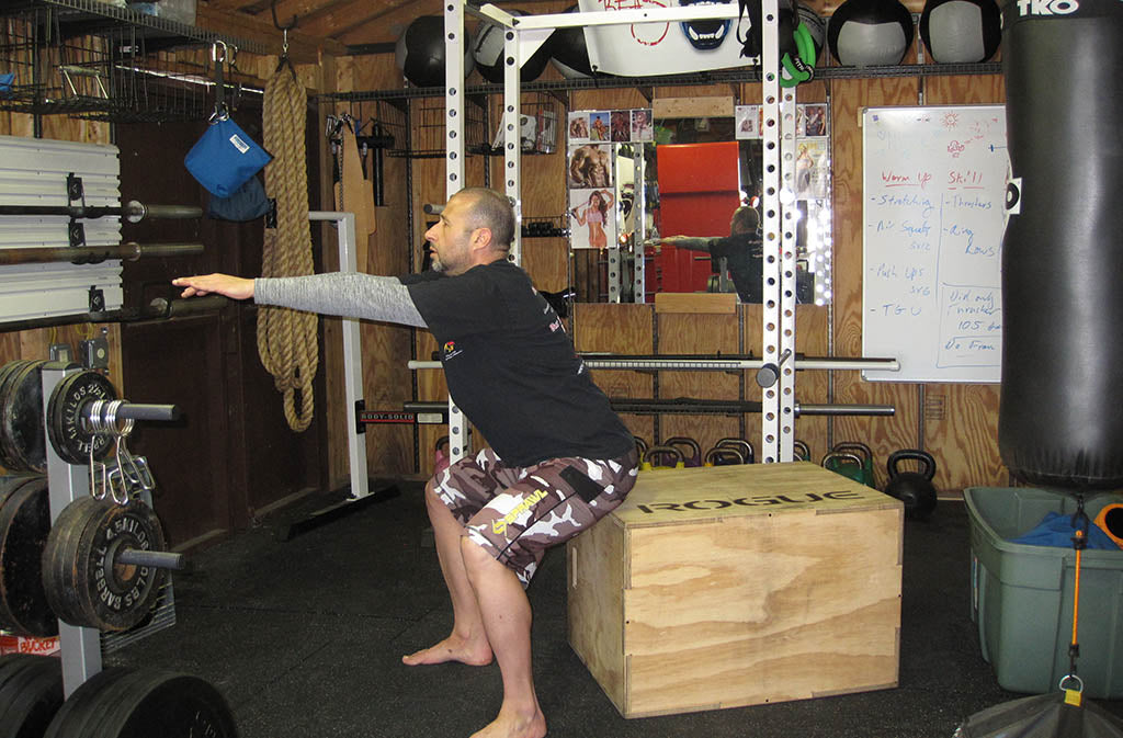 man doing a box squat
